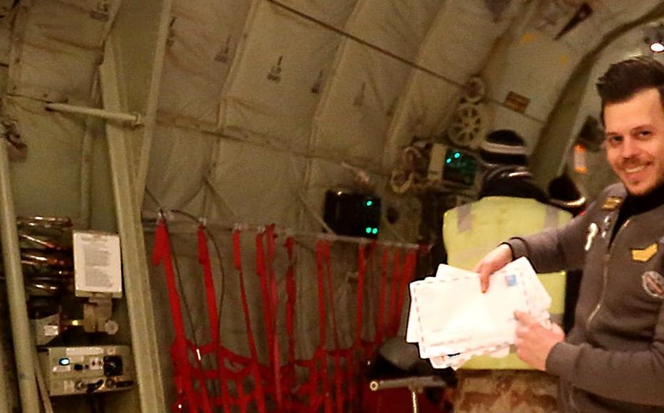 Maan inside the Iraqi airforce plane holding some of the letters to Mosul.