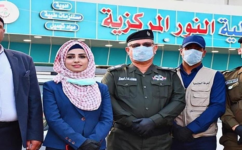 IWPR's champion Abrar Al-Ani (L) with the Anbar Community Police during Awareness Campaign on Covid_19 in Al Ramadi Market.