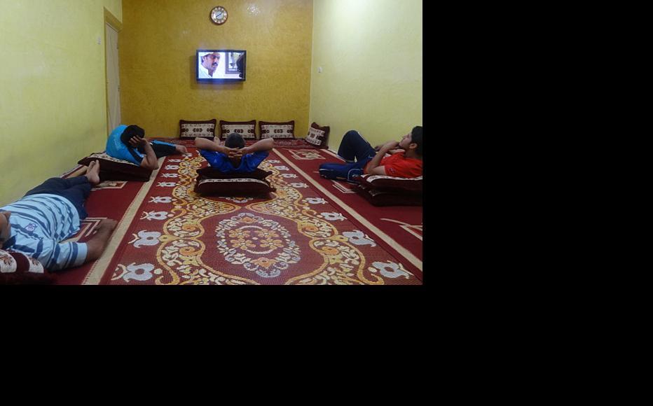 """Iraqis watching the Kuwaiti Drama """"Saher al-Layl"""". Basra, July 2012. (Photo: Abu Iraq)"""
