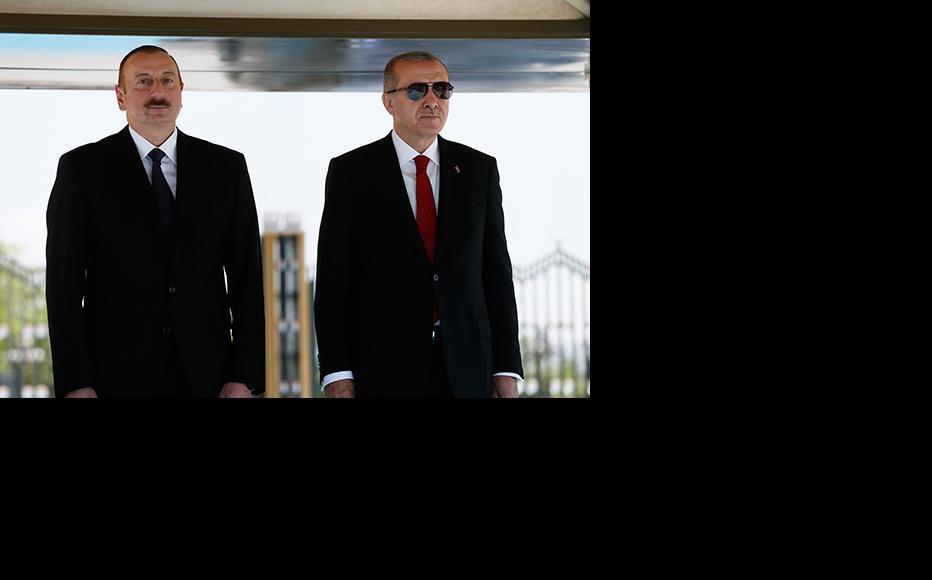 Turkish President Recep Tayyip Erdogan (R) with Ilham Aliyev, President of the Republic of Azerbaijan (L) at Turkish Presidental Palace in Ankara, Turkey, April 2018. (Photo: Turkish President Press Office via Getty Images)