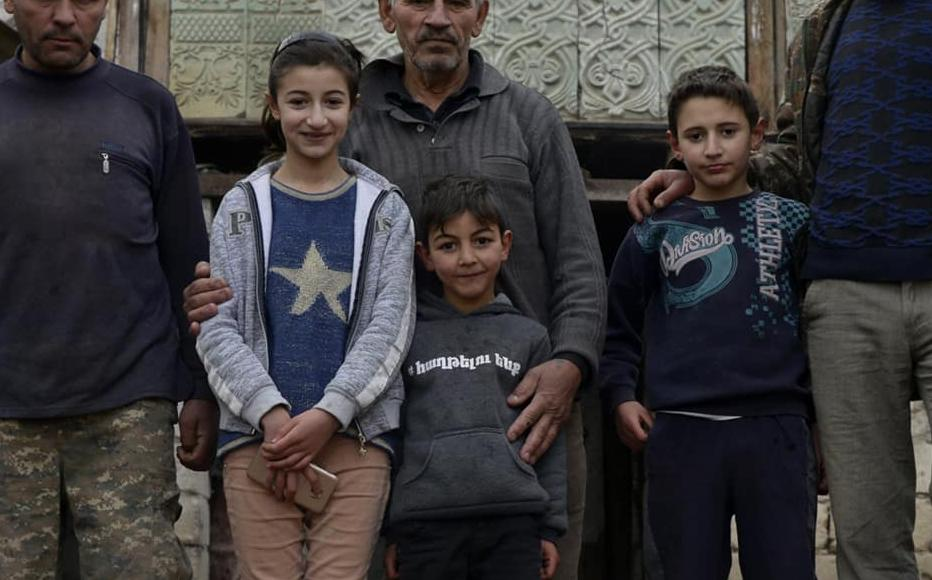 Galust with his sons Kajik and Gagik-a 42-year-old cattle breeder - and grandchildren.