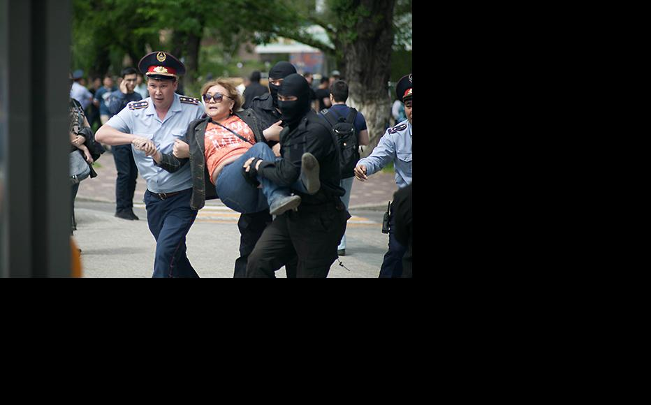 Police detain an opposition activist during recent protests in Kazakstan. (Photo: Inga Imanbay)