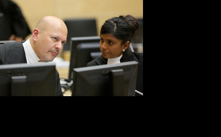 William Ruto's lawyers Karim Khan and Shyamala Alagendra consult during proceedings against their client. (Photo: ICC-CPI/Flickr)