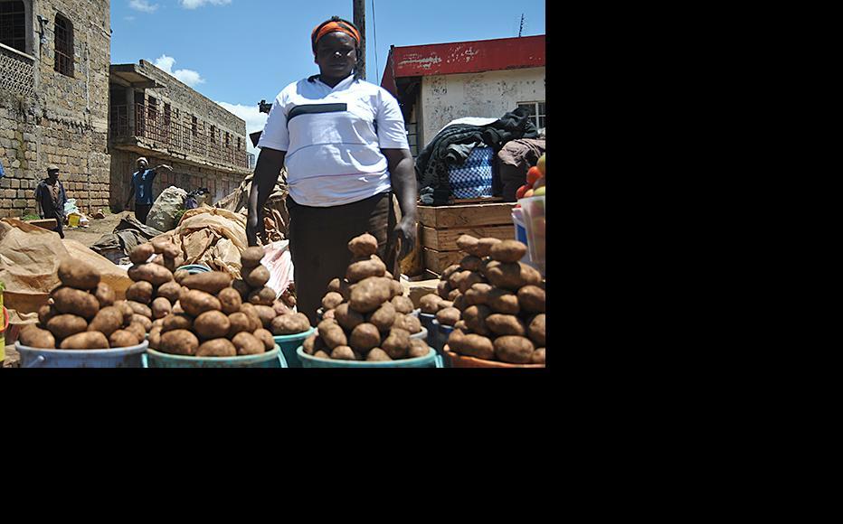 Violet Kayanga at her vegetable stall in Total. (Photo: Antony Langat)