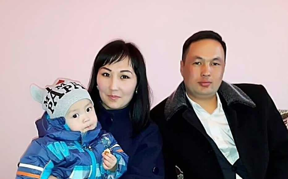 Nazik Akparova, the youngest deputy of the village council of Saruu in the Issyk Kul region of Kyrgyzstan with her son and husband.