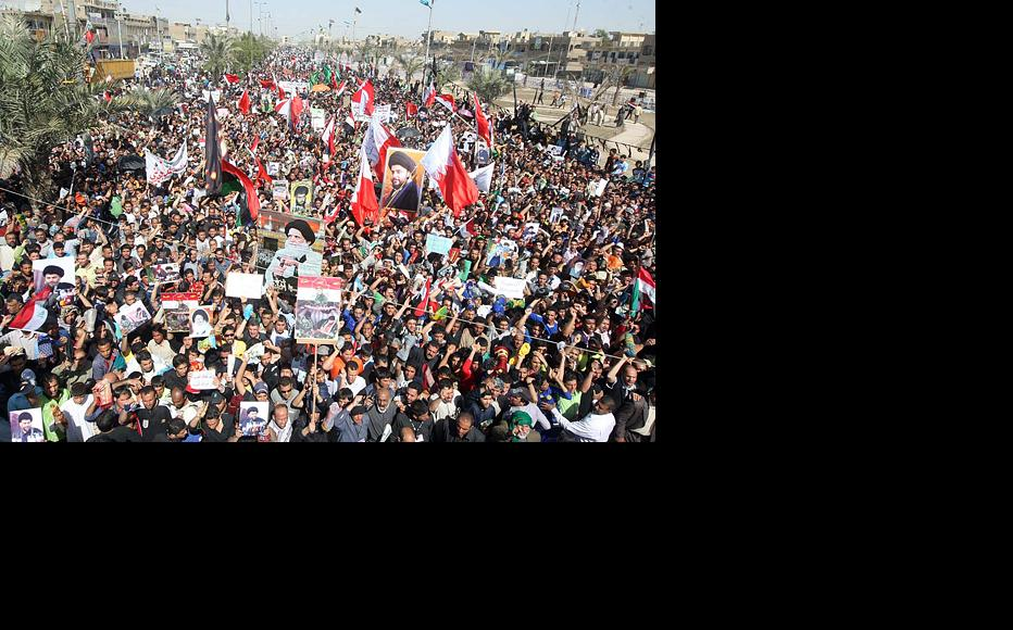 Thousands of people in Sadr City, Baghdad's largest district, protest on March 18 against the Bahrain government's crackdown on Shia demonstrators. Iraq's Shia say they are worried about the clampdown on protesters and the deployment of troops from Sunni-majority Gulf nations. (Photo: IWPR)