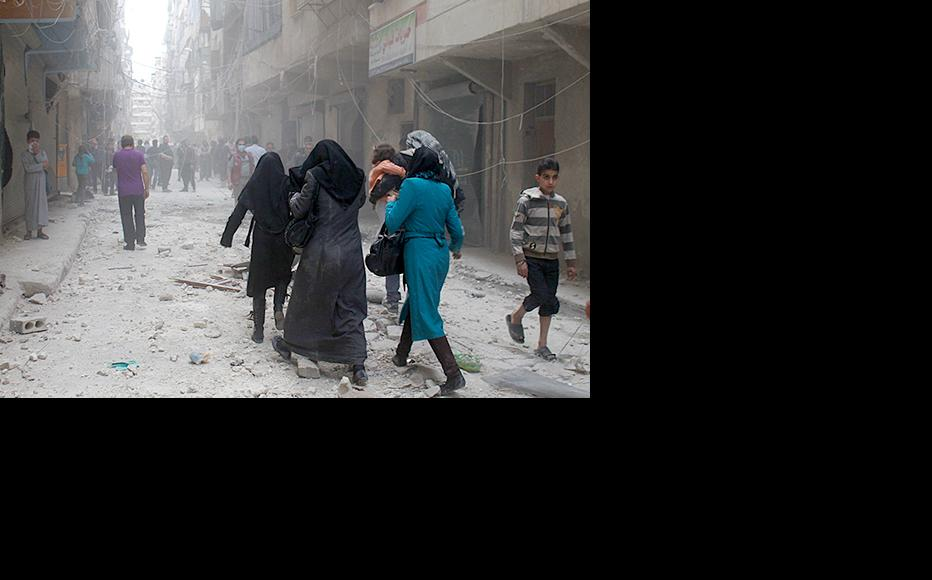 Women evacuating their houses after an airstrike on the Ansari neighbourhood in Aleppo. (Photo: Baraa al-Halabi)
