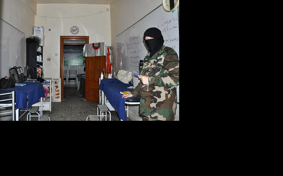 A female opposition militant at a medical office in Salaheddin neighbourhood, Aleppo. (Photo: Baraa al-Halabi)