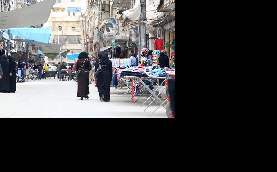 Women shopping at a local market in Aleppo's al-Shaar neighbourhood. (Photo: Hussam Kuwaifatiyeh)