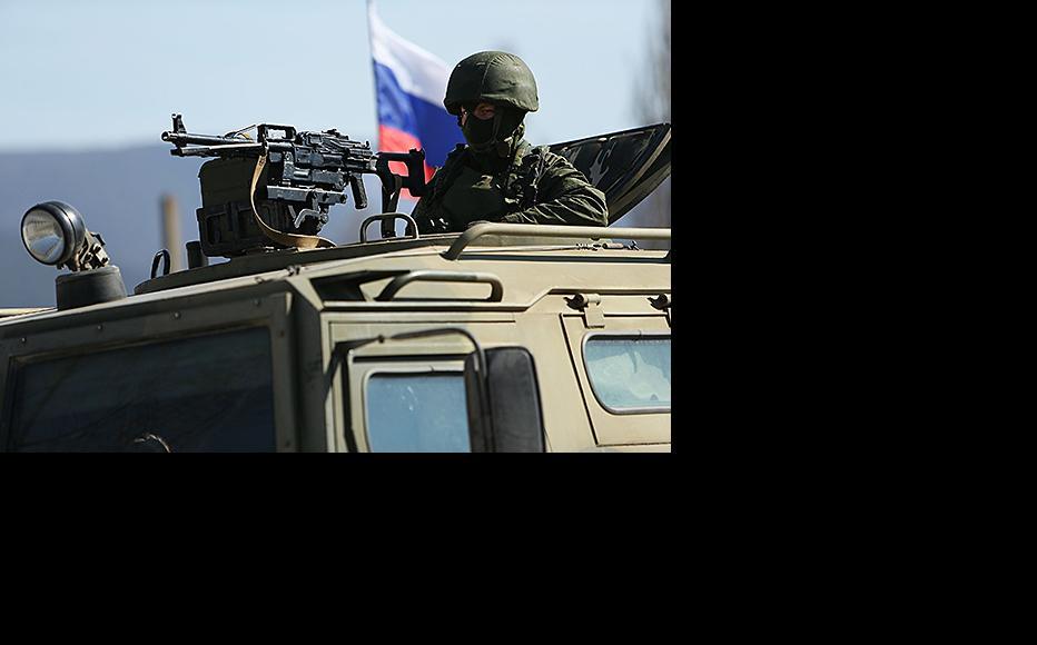 Russian military outside a Ukrainian base near Simferopol, March 11, 2014 . (Photo: Spencer Platt/Getty Images)