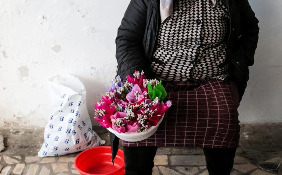 Salomat lives in a mountain village near Tashkent and sells flowers from her garden and the surrounding fields. Prices start at 1,000 som, or only one cent. She stands outside the subway station and sells her flowers before they wither; or before the police come and move her on.