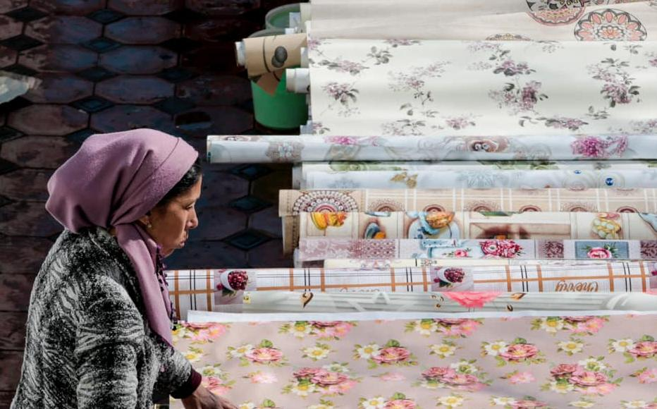 Nasiba sells oilcloth in a homeware shop in Chorsu.