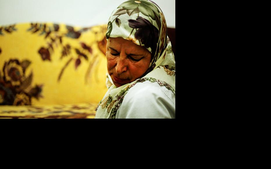 Protected witness Z.R. praying. (Still from Unprotected, film by IWPR directed and shot by Mirko Pincelli/Pinch Media)