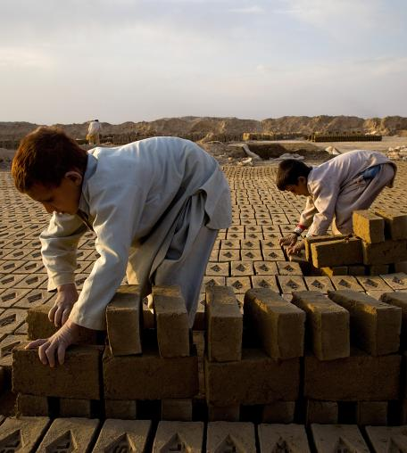 Roman , 7, sorts bricks at the Sadat Ltd. Brick factory where he works from 8am to 5pm daily, Kabul, Afghanistan.