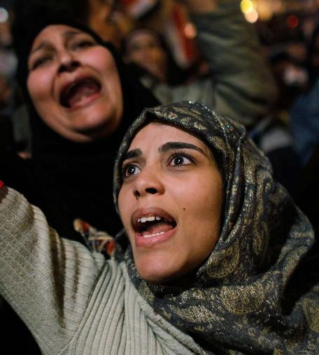 Women cheer in Tahrir Square after it is announced that President Hosni Mubarak was giving up power on Feburary 11, 2011 in Cairo, Egypt. © Chris Hondros/Getty Images