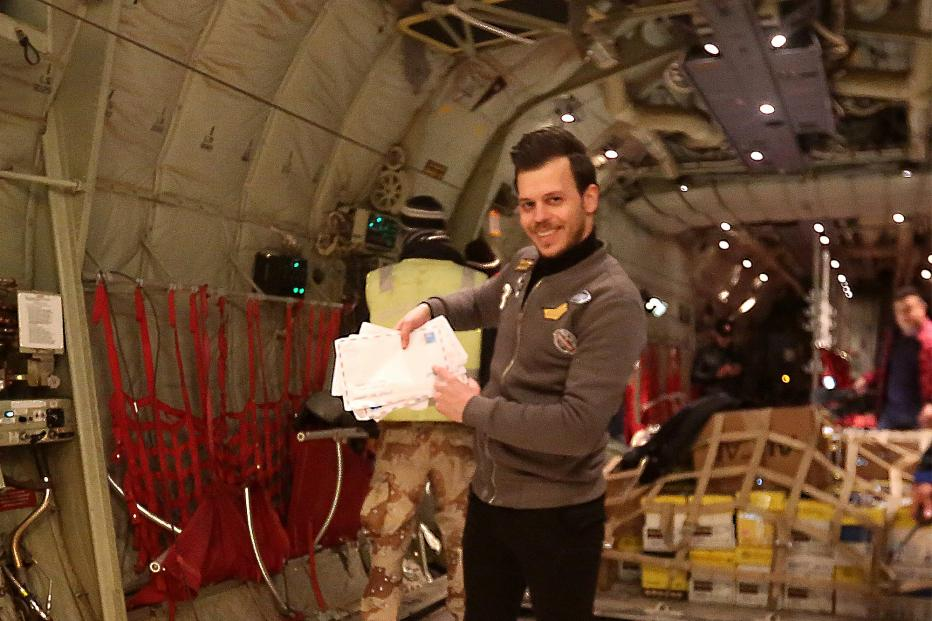 Sakar Maan, one of the activists that lead the initiative, inside the Iraqi airforce plane holding some of the letters about to be dropped over Mosul.