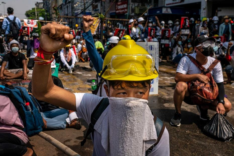 Anti-coup protesters prepare for a clash with riot police on March 02, 2021 in Yangon, Myanmar. Myanmar's military government has intensified a crackdown on protesters in recent days, using tear gas and live ammunition, charging at and arresting protesters and journalists.
