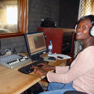 IWPR Uganda trainee Giliian Lamunu working on a radio story.