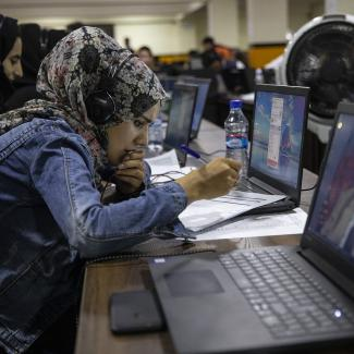 Campaign worker answers phone calls in a call centre for irregularities from various polling stations a day after the elections on September 29, 2019 in Kabul, Afghanistan.