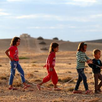 Children play in a field as Turkish Armed Forces dispatch tanks to the Turkish - Syrian border as clashes intensified with Islamic State of Iraq and Levant (ISIL) militants on September 29, 2014.