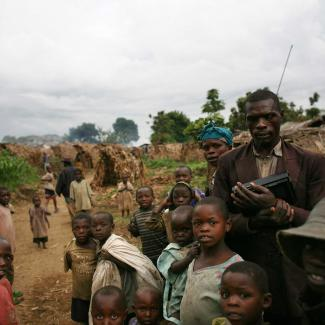 Refugees wait near their shelters in the village of Tongo, in the hills outside Goma, on November 4, 2008 in North Kivu province, Democratic Republic of Congo.
