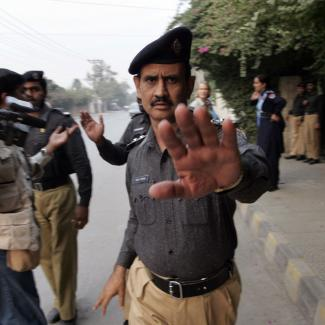 Pakistani police block journalists.