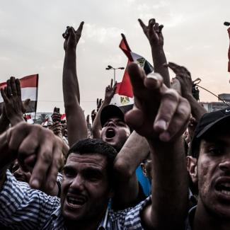 Supporters of Mohamed Morsi, the Muslim Brotherhood's candidate, protest against Egypt's military rulers in Tahrir Square and celebrate a premature victory on June 23, 2012 in Cairo, Egypt.