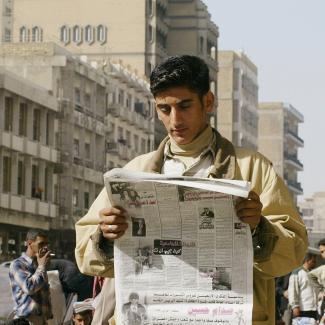 An Iraqi man reads a newspaper in Baghdad, Iraq.