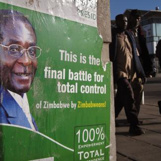 A campaign poster for President Robert Mugabe is posted along a city street June 21, 2008 in Bulawayo, Zimbabwe. Human rights groups have accused Mugabe's ruling party of mass voter intimidation and violence against the political opposition ahead of the scheduled June 27 presidential runoff vote between President Mugabe and opposition candidate Morgan Tsvangirai.