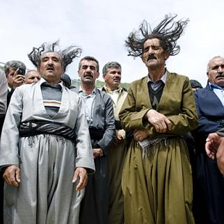 Male followers of the Qadriya sect engage in traditional acts of worship in Barzinja, a small mountainous village, east of Sulaimaniyah city in Iraqi Kurdistan. Sheikh Abdul-Qadir Gilani founded the sect in Baghdad in the late 11th century. Photo by Kamaran Najm/Metrography.