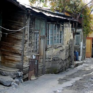 Homes in Kond are patched up with wood, metal or plastic as residents do not want to invest in more lasting repairs, since demolition could come at any time. (Photo: Mary Aleksanyan)