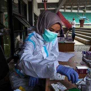 An Indonesian nurse works with a rapid test for the Covid-19 Coronavirus at a football stadium which was used as a hospital for Covid-19 patients.