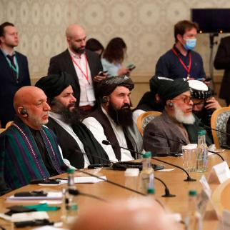 Former Afghan president Hamid Karzai (L) and Taleban co-founder Mullah Abdul Ghani Baradar (2R) attend an international conference on Afghanistan over the peaceful solution to the conflict in Moscow on March 18, 2021.