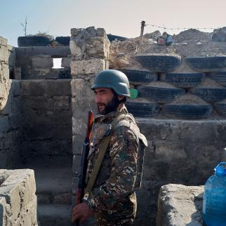 An Armenian soldier stands in the trenches on a frontline position on October 20, 2020 near Aghdam, Nagorno-Karabakh.