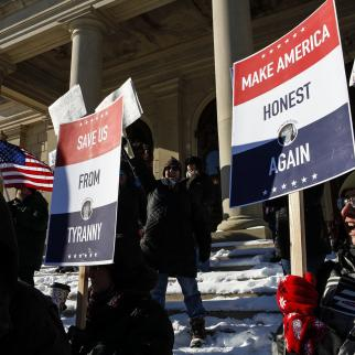 Protestors rally at the Michigan State Capitol.