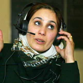 Female presenter working on a news package for a radio station in Kabul.