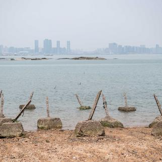 Aged anti-landing barricades are positioned on a beach facing China on the Taiwanese island of Little Kinmen which, at points lies only a few miles from China.