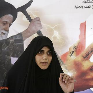 Iraqi legislator Maha al-Douri addresses supporters of radical Shia cleric Muqtada al-Sadr and his father, the late Grand Ayatollah Mohammad Sadeq al-Sadr in Baghdad (pictured above). Douri, a prominent Sadrist leader, won more votes than any other female candidate in Iraq's 2010 parliamentary elections. (Photo: Eye Media Agency)