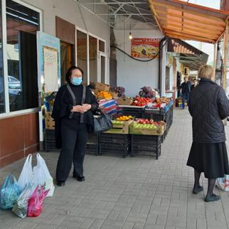 Two women stand outside a store in Sukhum (also known as Sukhumi). (Photo: Anaid Gogoryan)