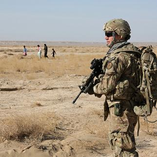 US Navy serviceman on security detail in Farah province. The Afghan president is resisting conditions set out in a security pact which Washington says are essential if American forces are to remain beyond 2014. (Photo: ISAF Public Affairs)
