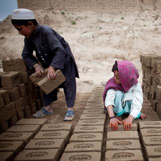 Afghan children sorting bricks at a brick factory in Kabul. (Photo: Majid Saeedi/Getty Images)