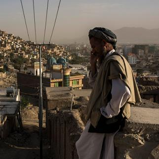 A man talks on the phone in the western neighbourhood of Kabul known as TV Hill. (Photo: Andrew Renneisen/Getty Images)