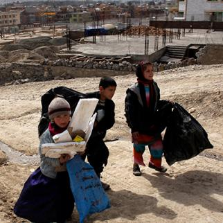 Kids collect garbage on the streets of Kabul to help their families. (Photo: Paula Bronstein/Getty Images)