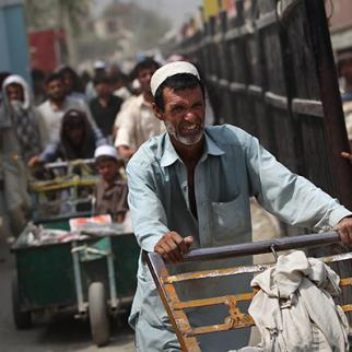Pedestrians pass through the Torkham border crossing between Pakistan and Afghanistan. (Photo: John Moore/Getty Images)
