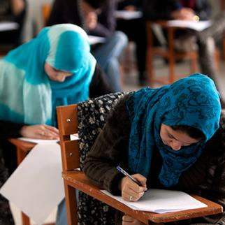 Young women study at an Afghan university. (Photo: Majid Saeedi/Getty Images)