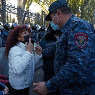 A woman confronts a police officer as protesters demand the removal of Armenian Prime Minister Nikol Pashinyan from office on November 11, 2020 in Yerevan, Armenia. (Photo: Alex McBride/Getty Images)