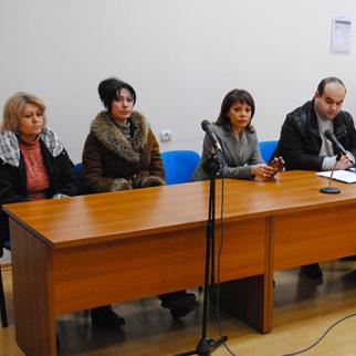 Marina Poghosyan (second from right) with members of the Chplakhyan family, whom she is defending. (Photo: Arman Gharibyan)