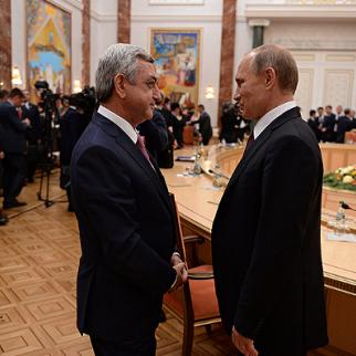 Armenian president Serzh Sargsyan (left) with his Russian counterpart Vladimir Putin after signing the Eurasian Economic Treaty on October 10, 2014. (Photo: Armenian president's website)