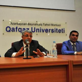 The Caucasus University meeting at which the new rector was announced. Shown left to right are former rector Ahmed Sanich, SOCAR vice-president Khalig Mammadov and current rector Elmar Gasimov. By APA(Photo: APA)