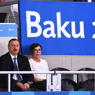 President of Azerbaijan Ilham Aliyev and First Lady Mehriban Aliyeva look on from the stands during a taekwondo event at the European Games in Baku. June 19, 2015. (Photo: Matthias Hangst/Getty Images for BEGOC)